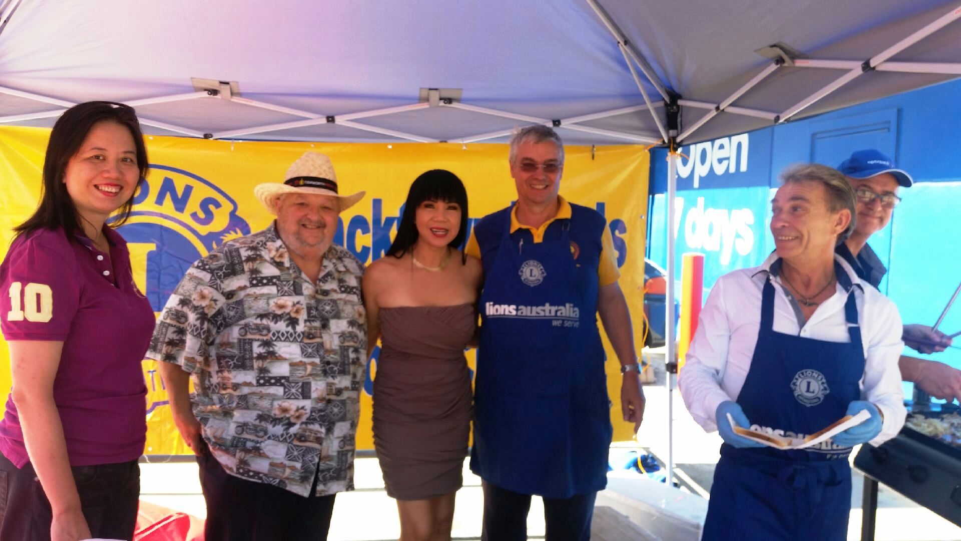 DG Elvio and others at Lions Give Back BBQ at Office Works